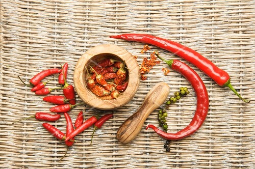 Chilli peppers in an olive wood mortar