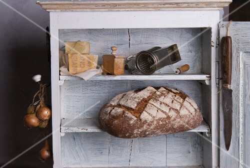 Bread and cheese on a wooden shelf
