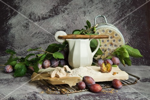 An arrangement of plums, yeast and flour