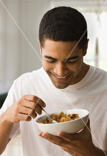 A man eating a bowl of cereal