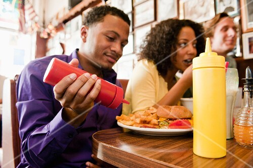 Young people eating in a fast food restaurant