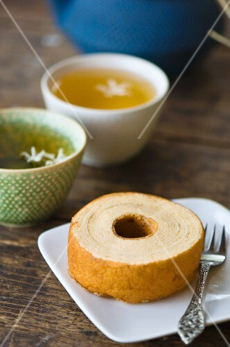 A slice of cake with jasmine tea (Asia)