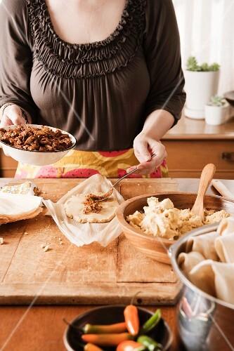 A woman preparing tamales