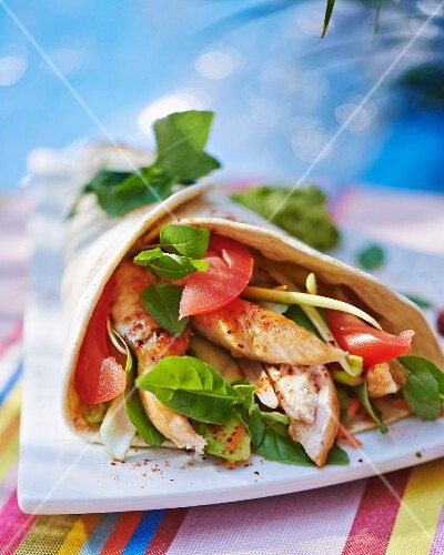 A chicken, tomato and avocado wrap