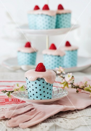 Raspberry cupcakes with cream cheese frosting and vintage gloves