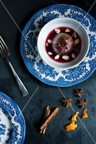 Poached fig in red wine with spices.