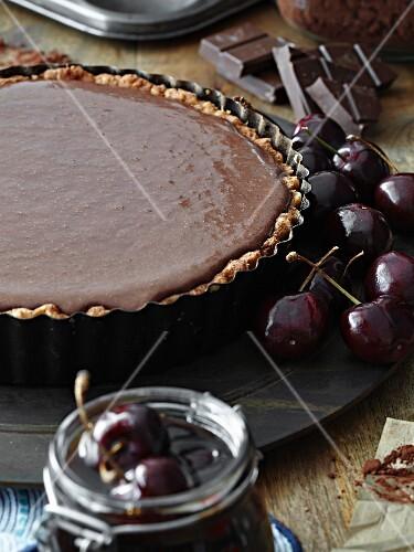 A chocolate tart in the baking tin