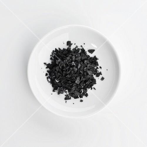 A plate of black sea salt grains