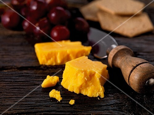 double gloucester cheese with grapes and crackers