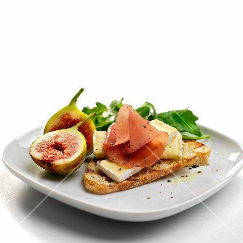 italian dry cured ham with brie cheese and figs