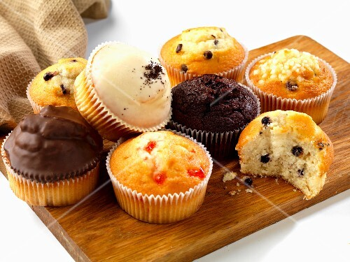 various muffins on a board