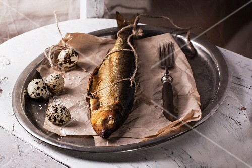 Smoked fish and quail eggs on vintage tray