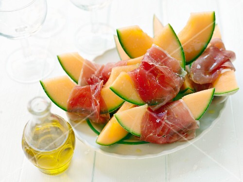 Cantaloupe melon wrapped in ham