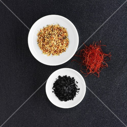 Various spices on a slate platter