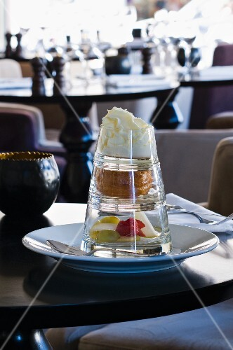 A three tiered desert on a table in a restaurant