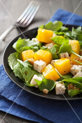 Rocket salad with pumpkin, feta and walnuts