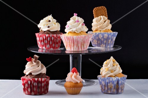 Six cupcakes with different decorations