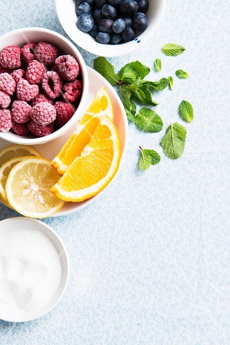 Frozen raspberries, fresh oranges, lemons, blueberries, mint and sugar