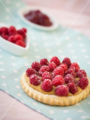 Raspberry tartlets and fresh raspberries