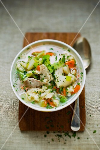Chicken soup with vegetables and parsley
