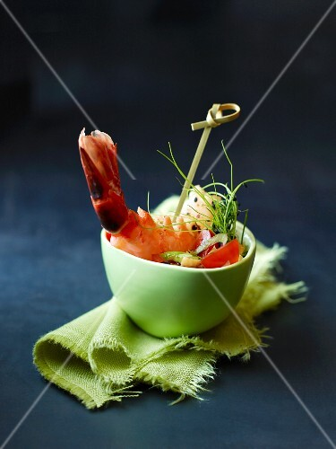A bowl of prawns with vegetables and chives