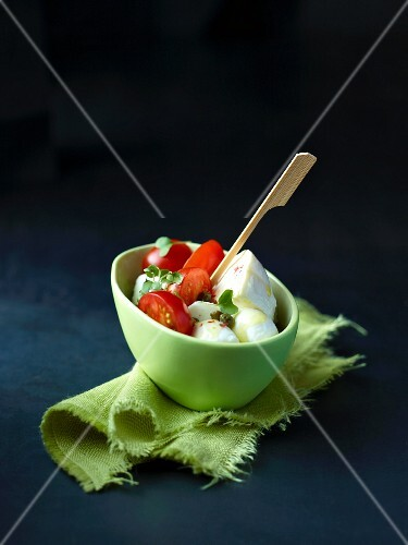 A bowl of tomato and mozzarella