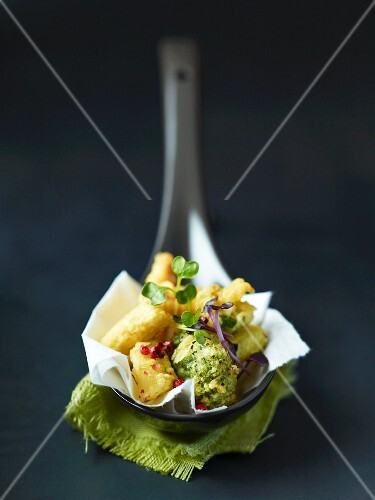 Tempura with cress on a spoon