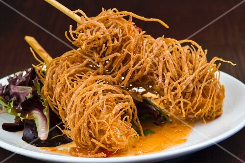 Shrimps on a sticks covered in deep fried won ton strips
