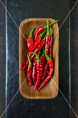 Red chillies in wooden bowl