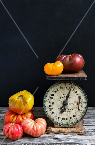 An old-fashioned pair of scales and colourful tomatoes