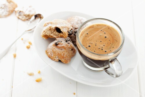 An espresso served with pine nut biscuits (Italy)