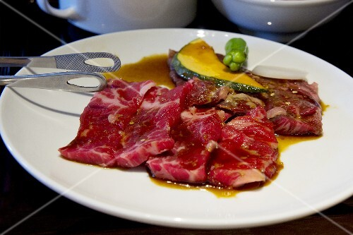 Wagyu marinated in soy sauce and sake with pumpkin, ocra and onion