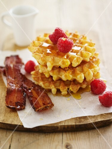 Waffles with bacon, maple syrup and raspberries