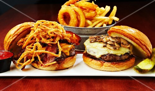 A cheeseburger with mushrooms, fried onions and bacon