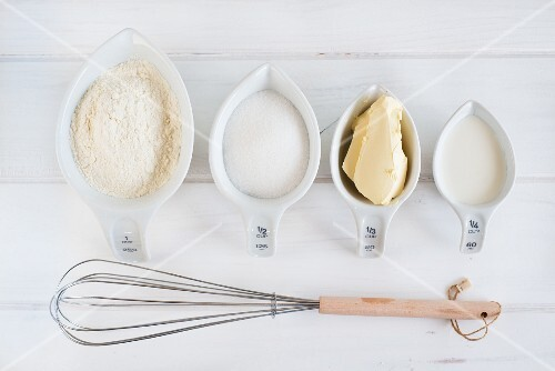 Baking Ingredients; Bowl of Flour; Eggs; Whisk