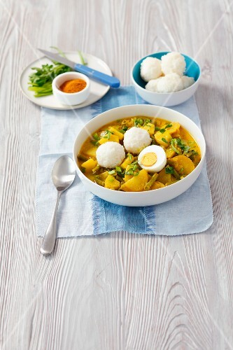 Vegetable curry with egg and rice dumplings