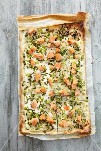 Tarte flambee with salmon trout and spring onions