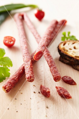 Savoury snack sausages with bread and tomatoes