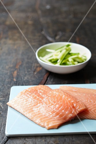 Fresh salmon fillets and cucumber sticks