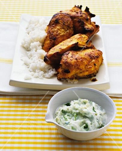 Tandoori chicken with rice and yogurt sauce