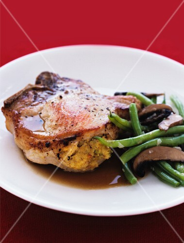 Stuffed pork chops with green beans and mushrooms