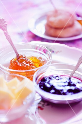 Marmalade, strawberry jam and butter for teatime