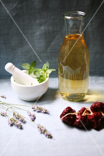 An arrangement of white wine, dried tomatoes, peppermint and lavender