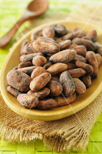 Cocoa beans in a wooden dish