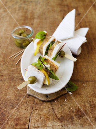 Tramezzini skewers with olives
