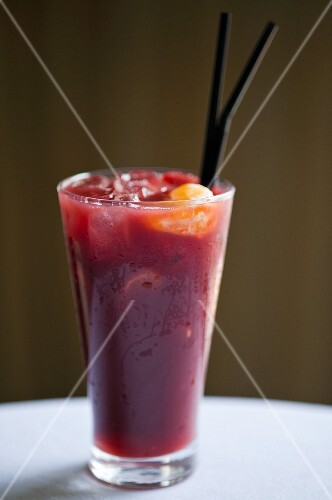 A berry smoothie with ice cubes