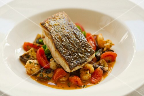 Seabass fillet with tomatoes, mushrooms and lychees
