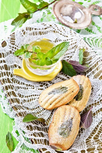 Madeleines with peppermint leaves