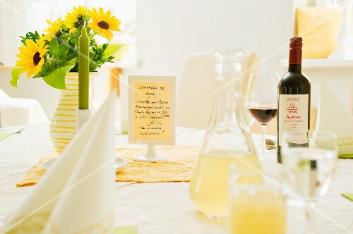 A table laid with sunflowers