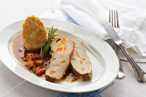 Roast veal studded with vegetables served with dumplings